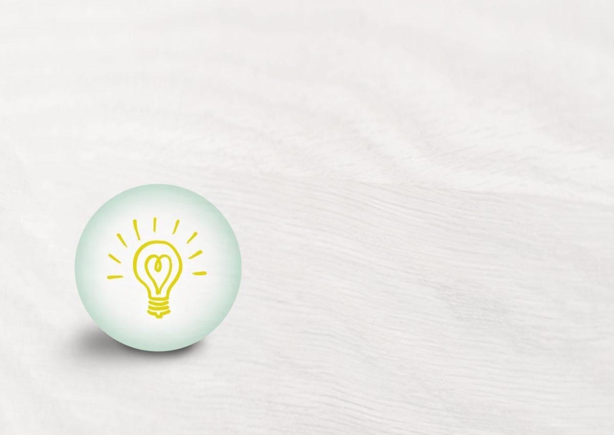 白い地面に丸く囲まれた豆電球が置かれている