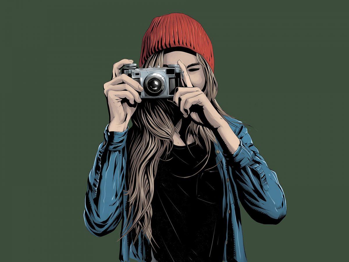 カメラを構える女性のイラスト
