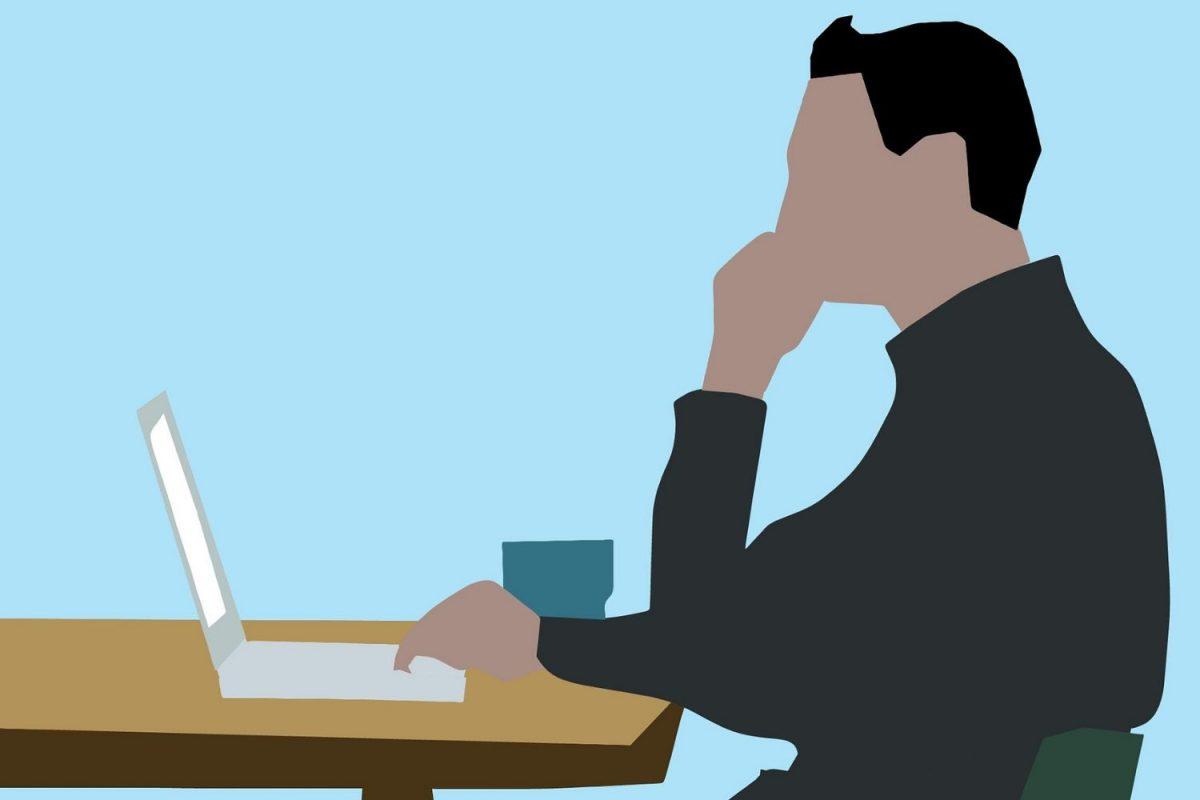 パソコンで作業をする男性のイラスト